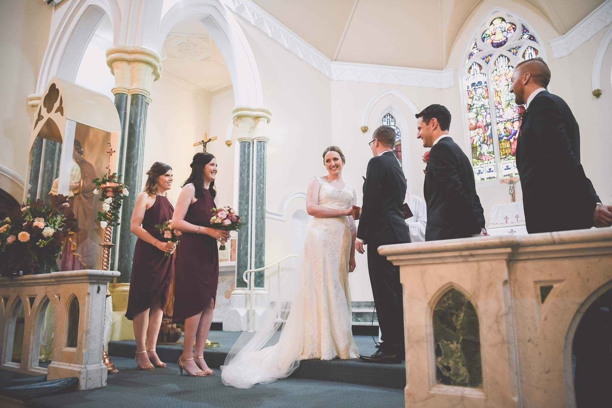 Melbourne wedding photography of a bride looking back at the audience from the altar on her wedding day. Melbourne wedding Photographer Pause the Moment captured this beautiful wedding photo