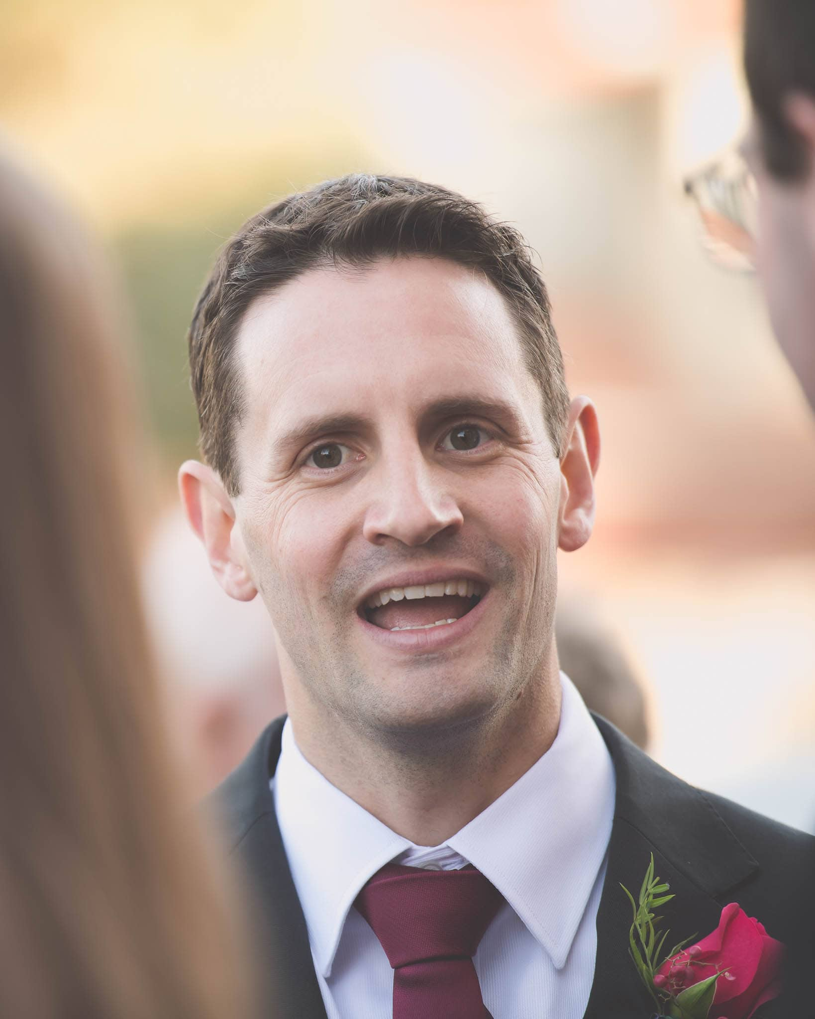 A groomsman smiles after a Melbourne wedding.
