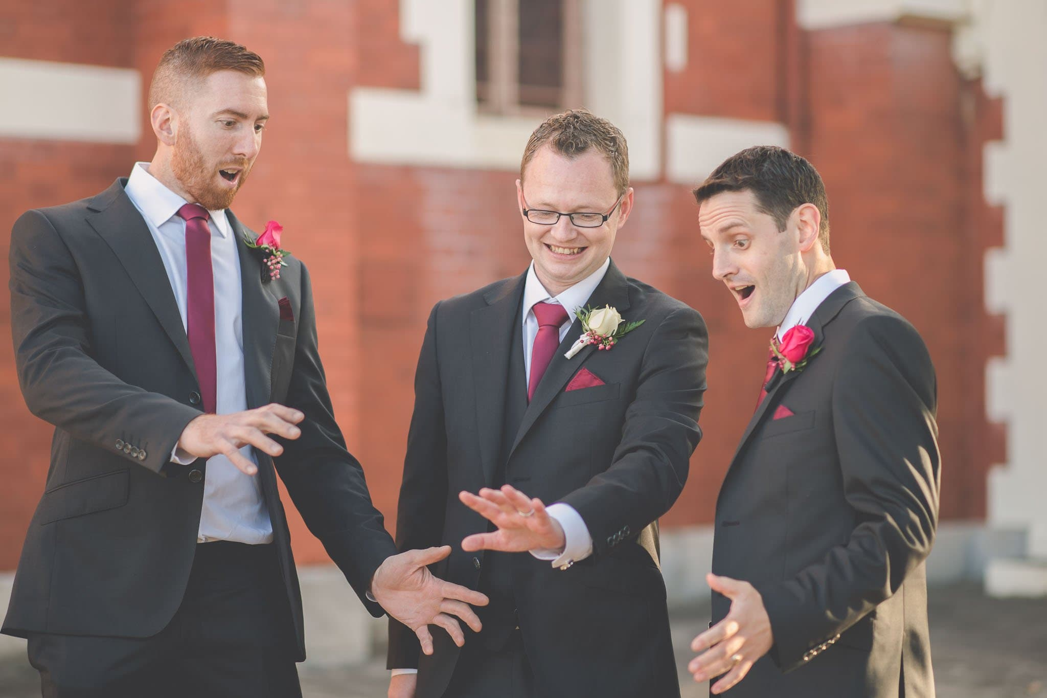 The groom and groomsmen mock a popular wedding photo taken by a lot of brides.