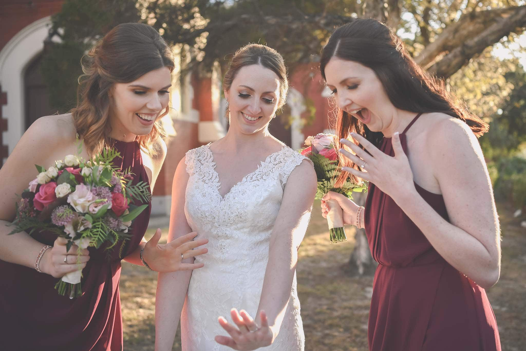 Beautiful wedding photography of a bride and her bridesmaids inspecting her new ring after her Melbourne wedding. Photography captured buy Pause The Moment.