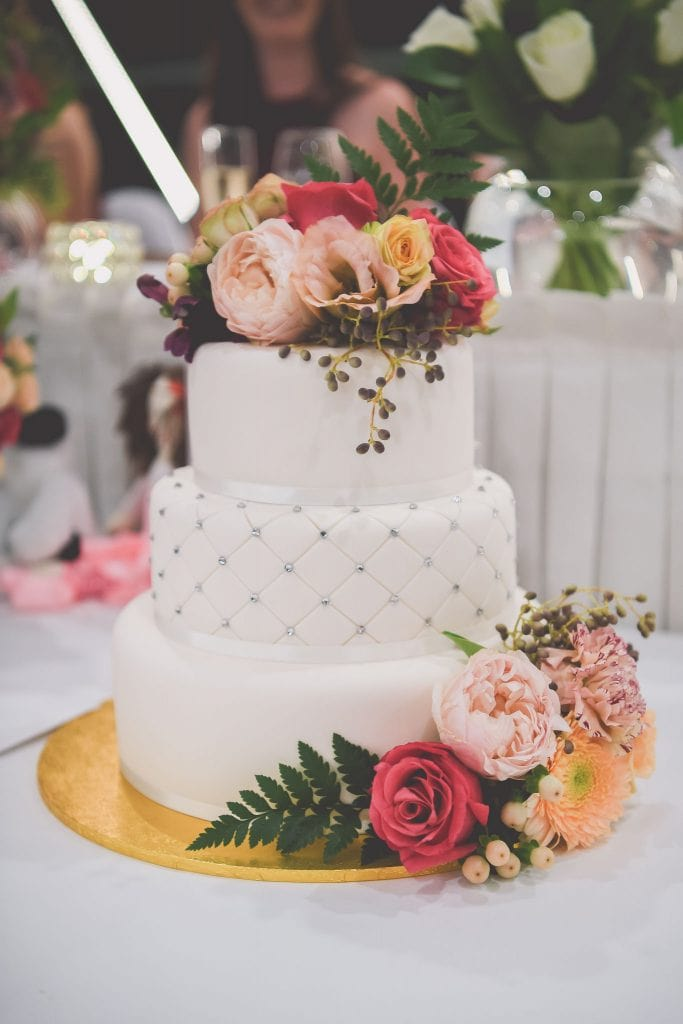 A beautiful wedding photo of a stunning wedding cake. lmage captured by Pause The Moment wedding photography Melbourne.