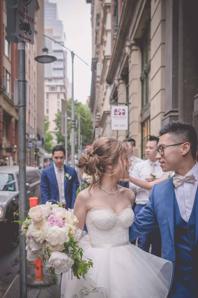 Melbourne wedding photography of the bride and groom walking down towards Degraves Street