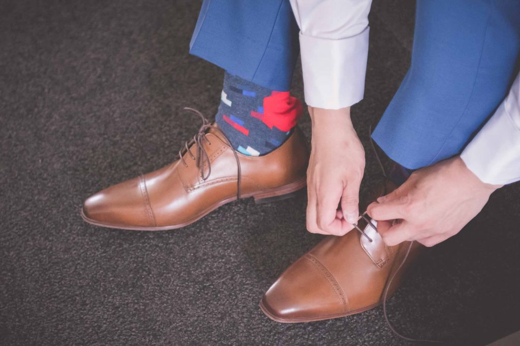 Melbourne wedding photography of the groom tying his shoes