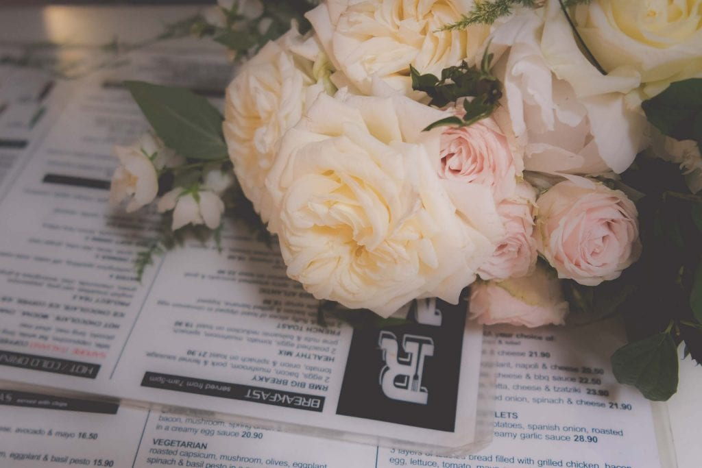 Melbourne wedding photography of the bouquet on top of a menu in Degraves Street