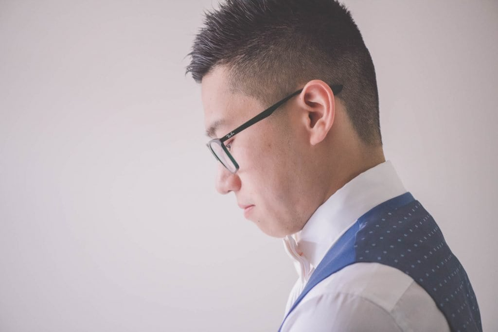 Melbourne wedding photography of the groom thinking
