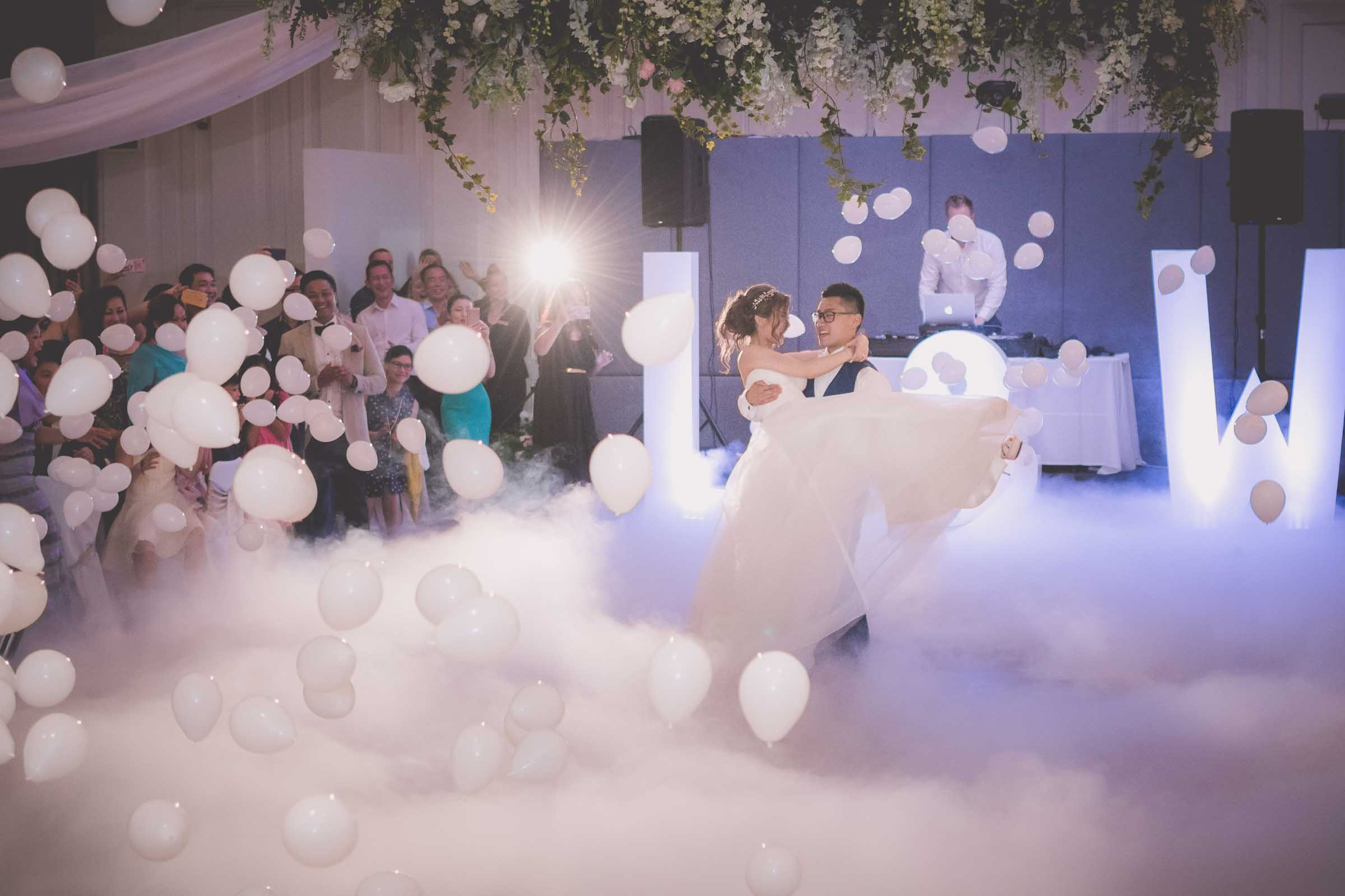 When you can't have your wedding photography in the rain you go indoors! Dancing and balloons at Leonda by The Yarra