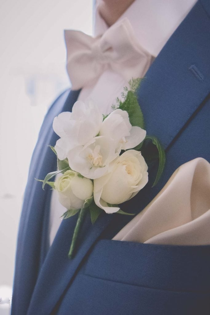 Melbourne wedding photography of the groom's boutonniere at a wet wedding