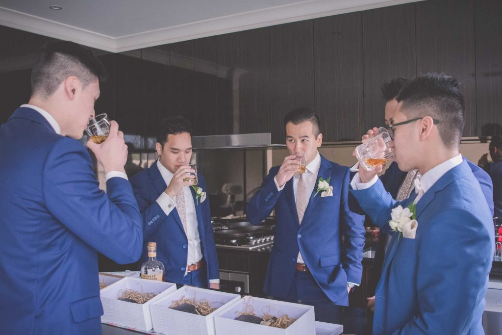 Melbourne wedding photography of the groom's party drinking whiskey