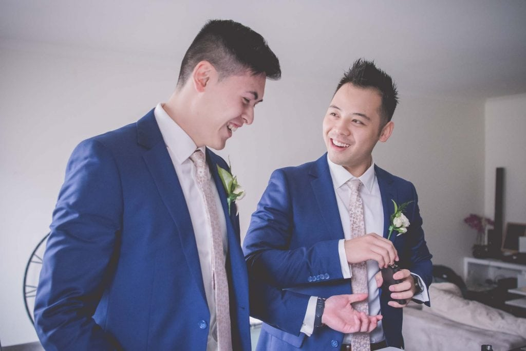 Melbourne wedding photography of a groomsman with a whiskey flask