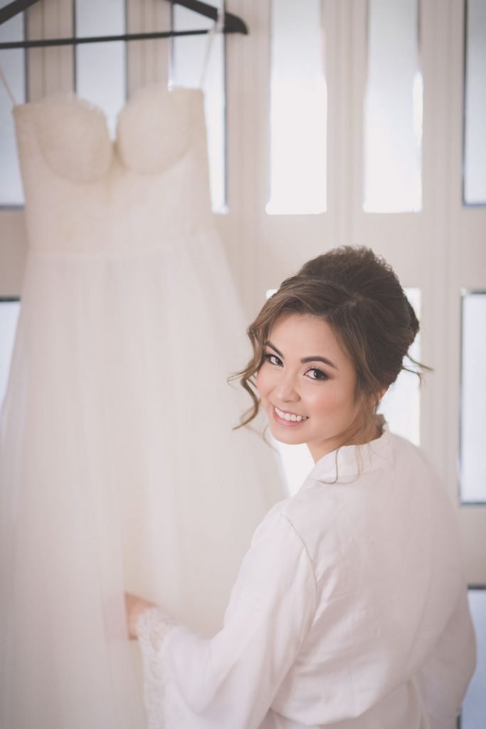 Melbourne wedding photography of beautiful bride Lina about to put on her wedding dress