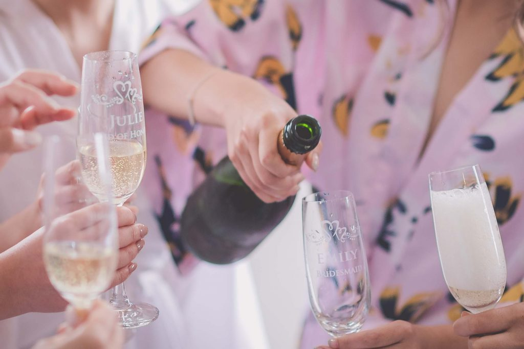 Melbourne wedding photography of a champagne bottle being poured
