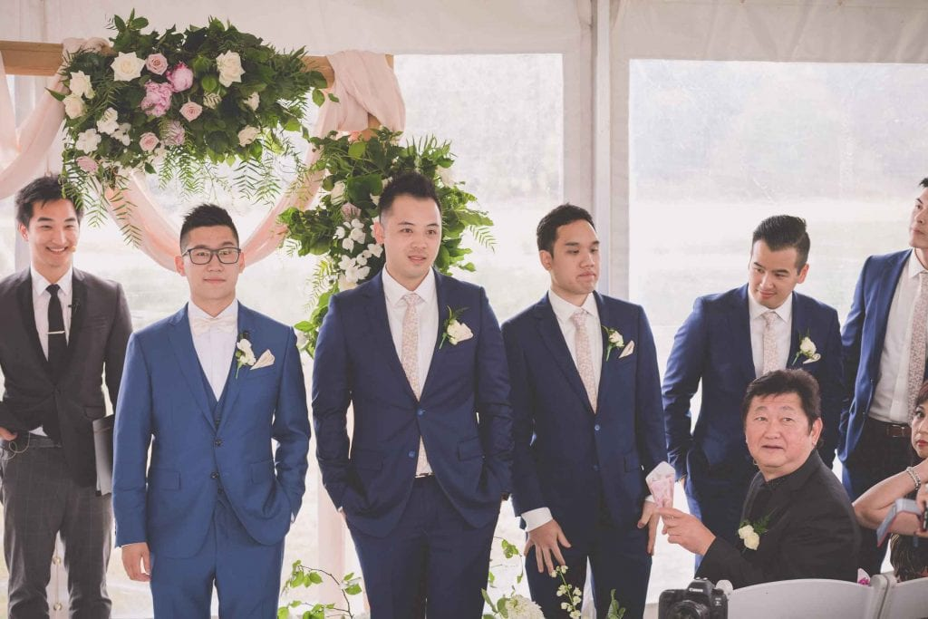 Melbourne wedding photography of the grooms party waiting at the ceremony