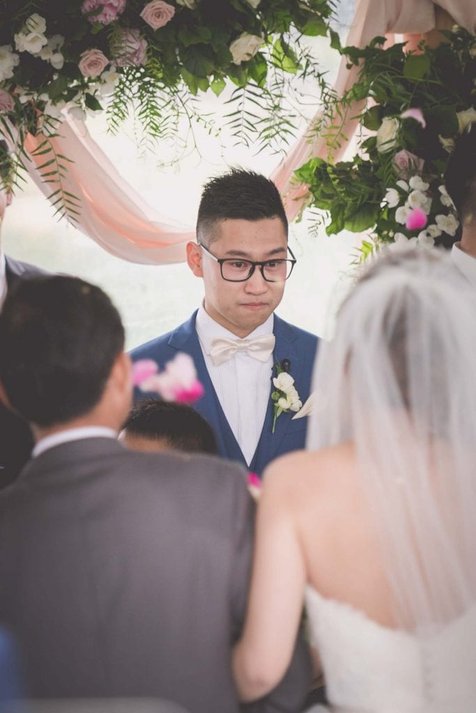 Melbourne wedding photography of a groom looking emotional as his bride arrives