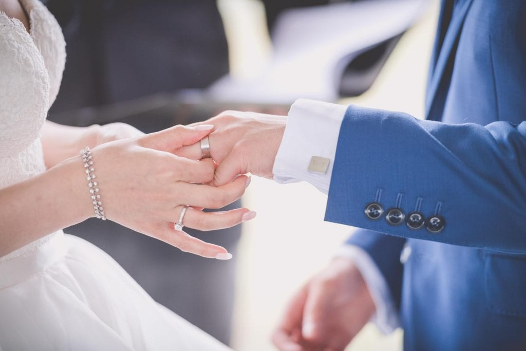 Melbourne wedding photography of the groom's ring being placed on his finger