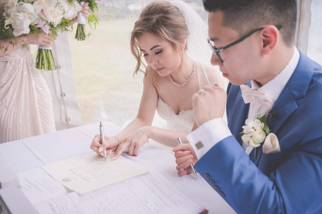 Melbourne wedding photography of the bride signing her paperwork