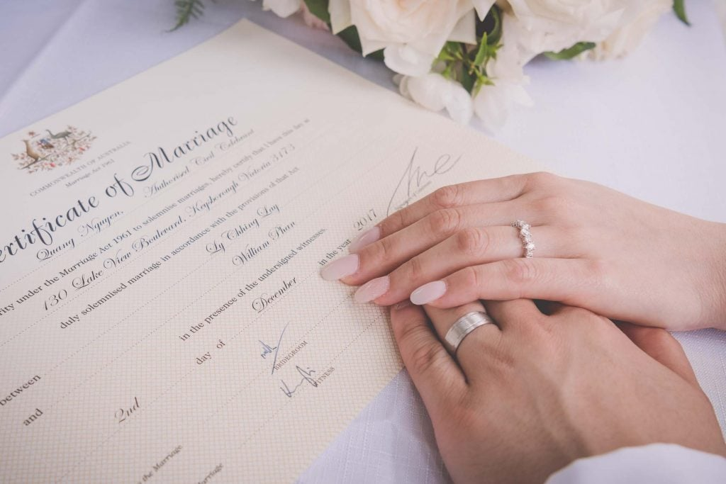 Melbourne wedding photography of the bride's and groom's hands on their marriage certificate