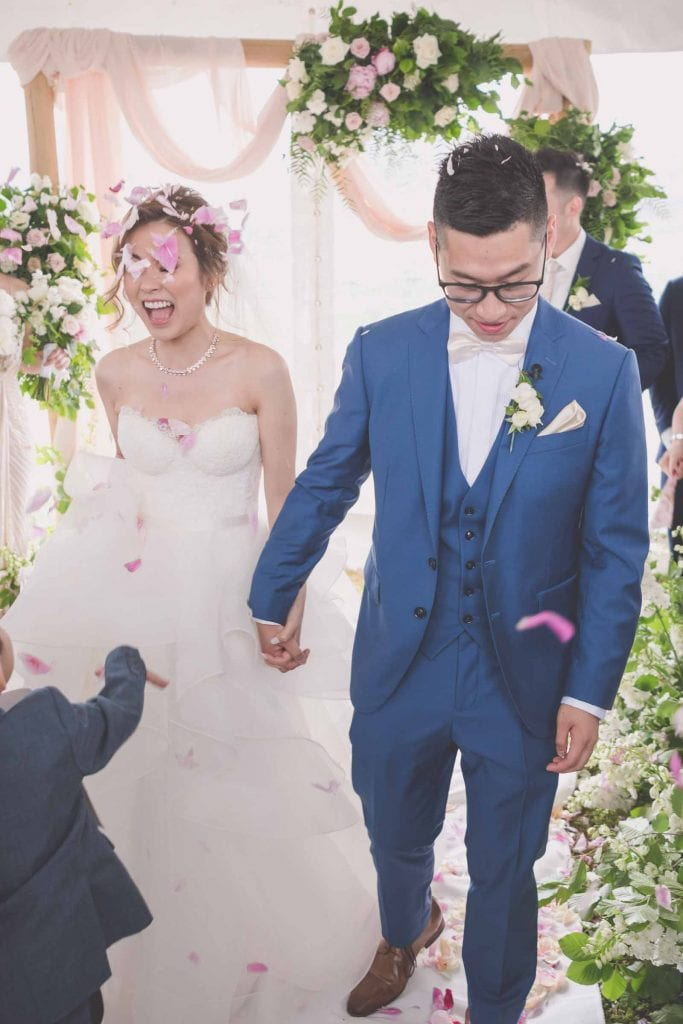 Melbourne wedding photography of flower petals being thrown on the couple