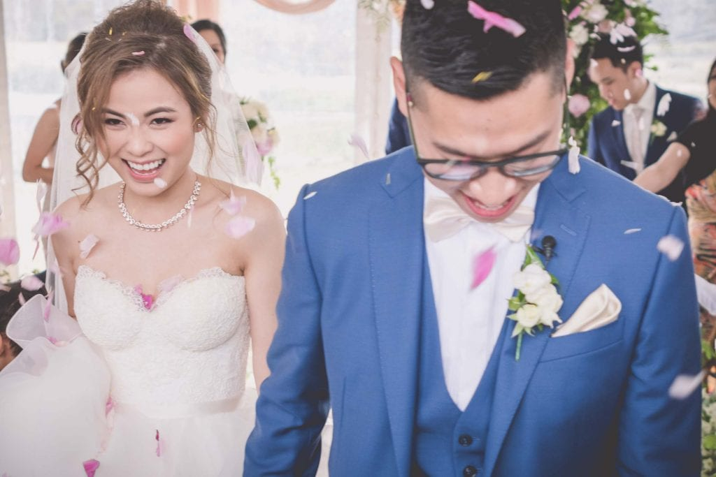 Melbourne wedding photography of flower petals being thrown on the bride and groom