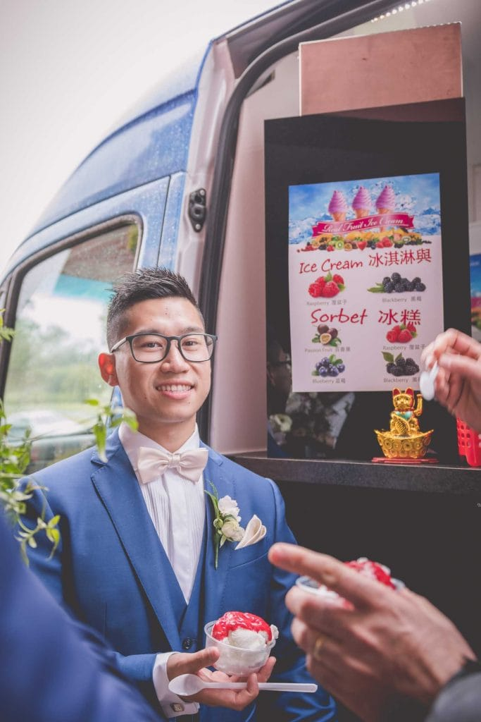 Melbourne wedding photography of the groom eating ice cream sorbet from the van
