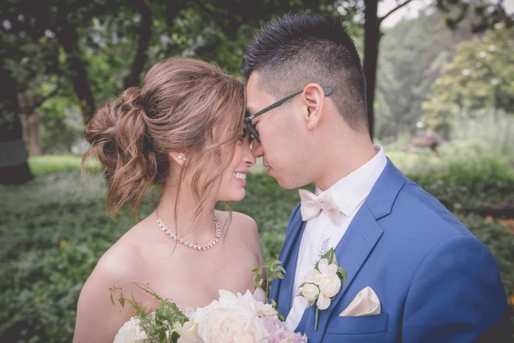 Melbourne wedding photography in Carlton Gardens of the bride and groom nuzzling