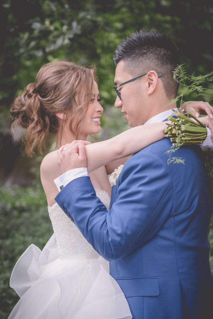 Melbourne wedding photography in Carlton Gardens of the bride and groom embracing
