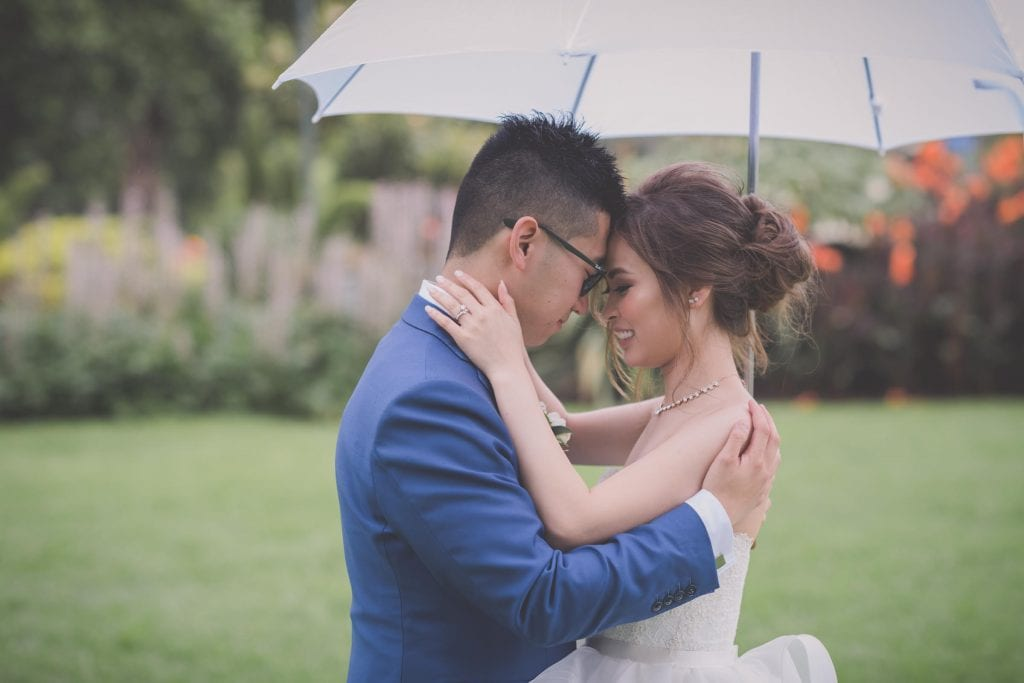 Melbourne wedding photography in Carlton Gardens of the bride and groom hugging with foreheads together