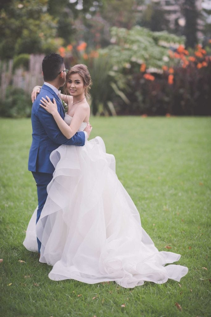 Melbourne wedding photography in Carlton Gardens of the bride and groom full length