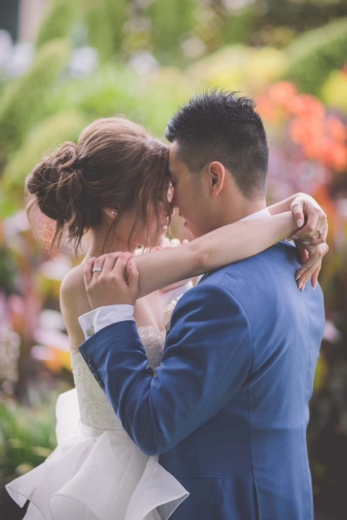Melbourne wedding photography in Carlton Gardens of the bride and groom nose to nose