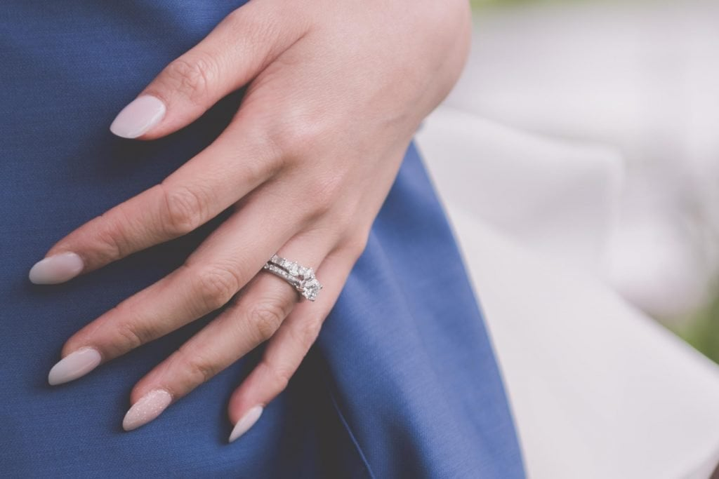 Melbourne wedding photography in Carlton Gardens of the bride's hand and ring
