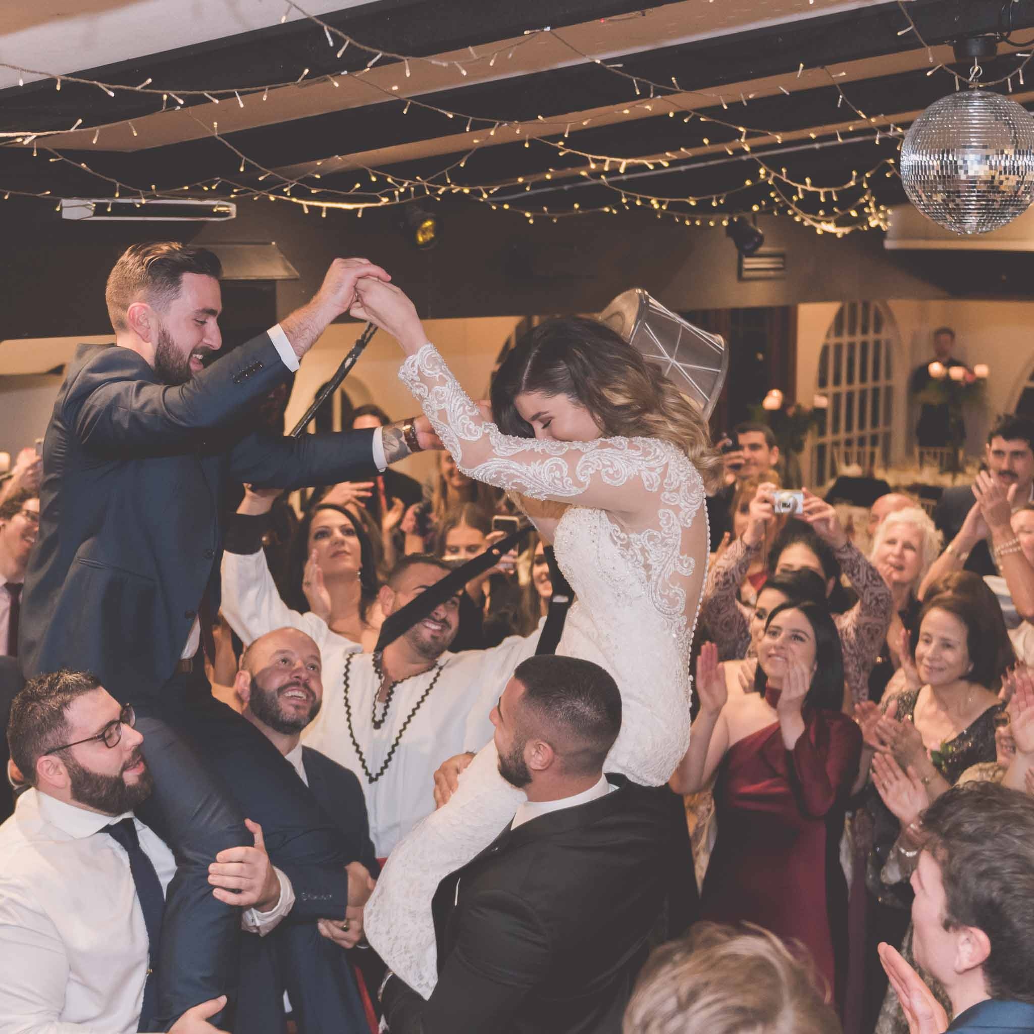 A Chateau Wyuna wedding with a bride and groom dancing on the shoulders of their guests