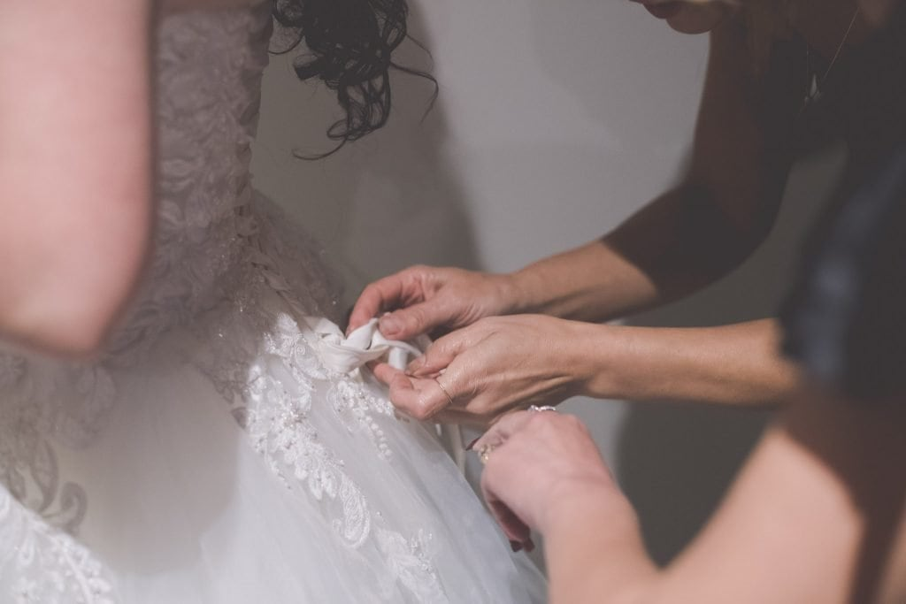 Tying up a wedding dress at a Melbourne wedding