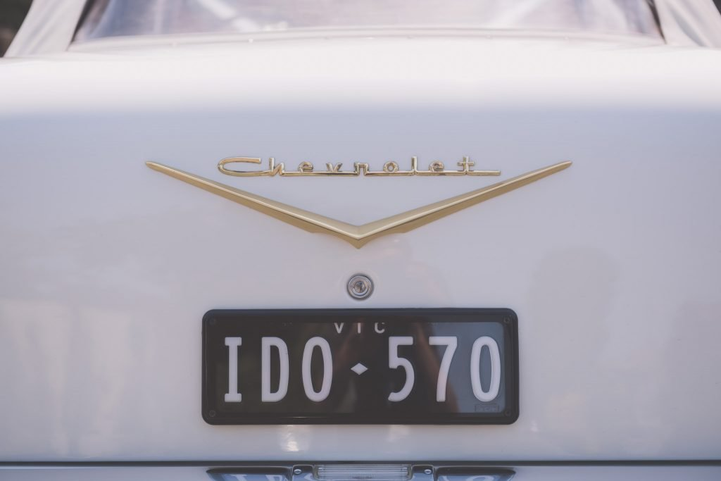 "The back of a white Chevrolet Bel Air with the Number Plate ""I DO"". These cars are very popular for Melbourne wedding photography."